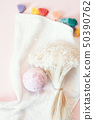 Natural cosmetics. Bath bomb, flowers and towel on pink pastel background 50390762
