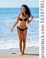 Young arabic woman with beautiful body in swimwear 50397901