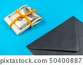 Prop Money Dollars and black envelope.Light blue 50400887