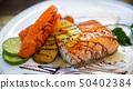 Salmon steak on dish in Grill seafood restaurant 50402384