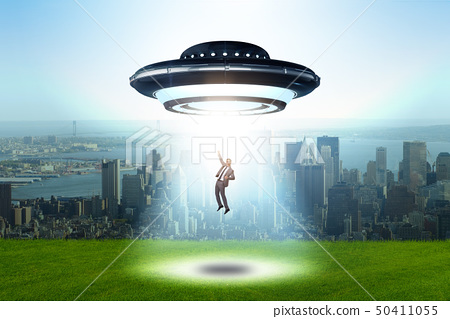 Flying saucer abducting young businessman  50411055