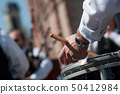 closeup of hand of drummer in scottish band 50412984