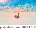 Aerial view of lying woman with swim ring 50414210
