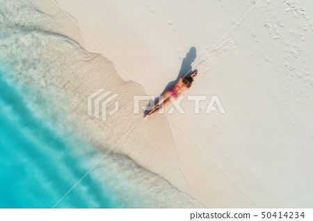 Aerial view of the back of sexy woman on the beach 50414234