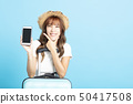 happy tourist girl in summer hat showing smart 50417508