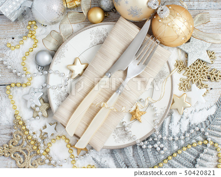 Silver and golden Christmas Table Setting 50420821