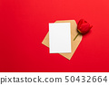 Letter, envelope in eco paper and red tulip on 50432664
