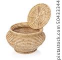wooden basket isolated on white background 50433344