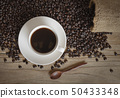 cup of coffee and coffee beans in a sack  50433348