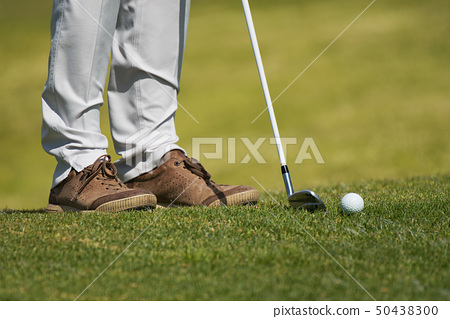 Playing golf preparing to shot 50438300