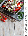 Greek salad on wooden tabe 50440521