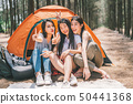 3 Asian girls doing victory pose at camping tent 50441368