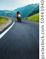 Motorcycle driver riding in Alpine highway, Nockalmstrasse, Austria, Europe. 50443940