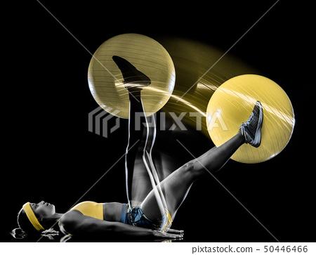 woman exercising fitness exercises isolated black background lightpainting effect 50446466