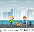 Happy Cheerful Children Walking in City Park 50448319