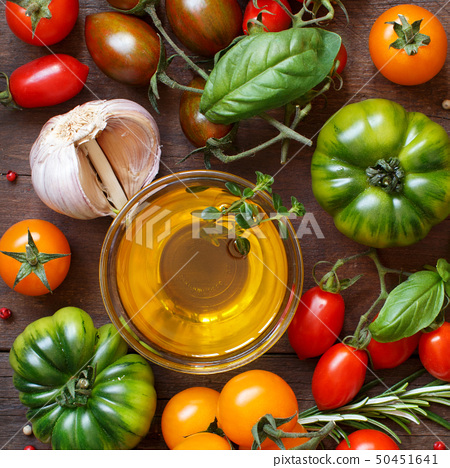 Colorful tomatoes, garlic, olive oil and herbs 50451641