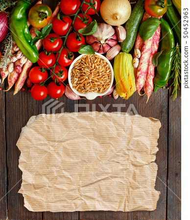Uncooked kamut grain with vegetables 50452963