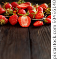 Strawberries on a dark  wooden table 50456140