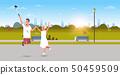 young couple using selfie stick taking photo on smartphone camera man woman jumping having fun city 50459509