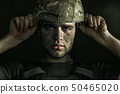Portrait of young male soldier 50465020