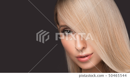 Beautiful blond girl with a perfectly smooth hair, and classic make-up. Beauty face. 50465544