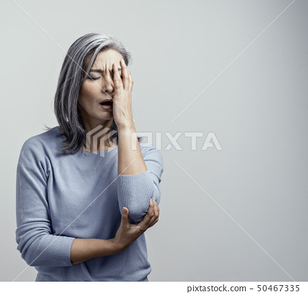 Asian woman in distress on white background 50467335