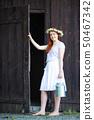door, woman, female 50467342