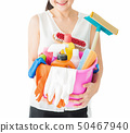 Woman with cleaning supplies and detergents on 50467940