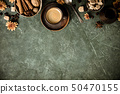 Coffee, flowers and spices on old green background 50470155