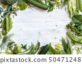 Green vegetables on a wooden table 50471248