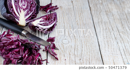 Red cabbage with a knife 50471379