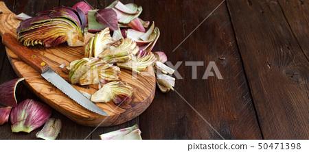 Roman Artichokes on a wooden board 50471398
