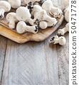 Champignon Mushrooms  on a table 50471778