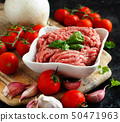 Minced meat with vegetables and spices 50471963