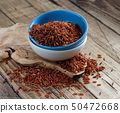 Uncooked Red rice in a bowl 50472668