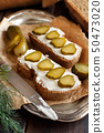 Sandwiches with cream cheese and salted cucumber 50473020