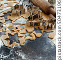 Cooking Christmas cookies with  cookie cutters 50473196