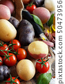 Raw potatoes and vegetables 50473956