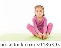 little girl practice yoga 50486395