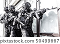 Police counter terrorist team squad storming building 50499667