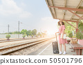 Hipster girl waiting train with leather vintage 50501796