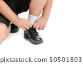 Thai student boy is tying the laces student shoe 50501803