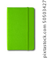 Green closed notebook isolated on white 50503427