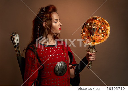 Medieval female warrior and pizza. 50503710
