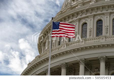 Washington DC capitol with waving flag 50505453