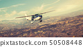 Small single engine airplane flying in the 50508448