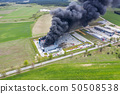 Aerial view of burnt industrial warehouse or 50508538
