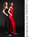 women, twins, red 50509571
