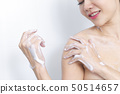Woman taking a shower enjoying water splashing on 50514657