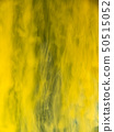 Yellow paint dissolving into water, abstract 50515052